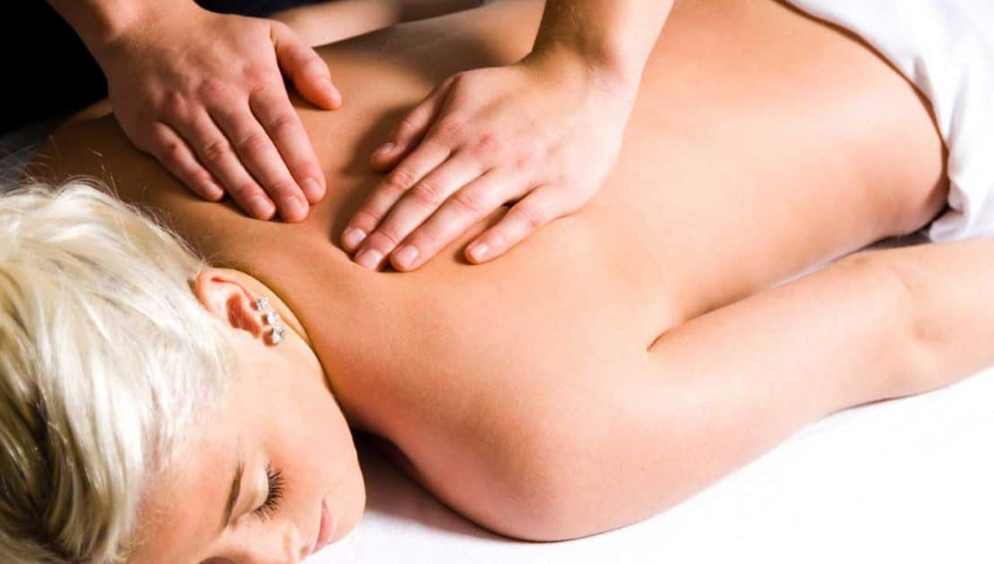 A VL Aesthetics' Massage Therapist Performing a Sports Massage